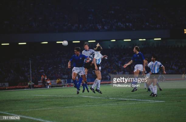 Argentine footballer Claudio Caniggia jumps to score the equalising goal for Argentina past Italian goalkeeper Walter Zenga during the semi final...