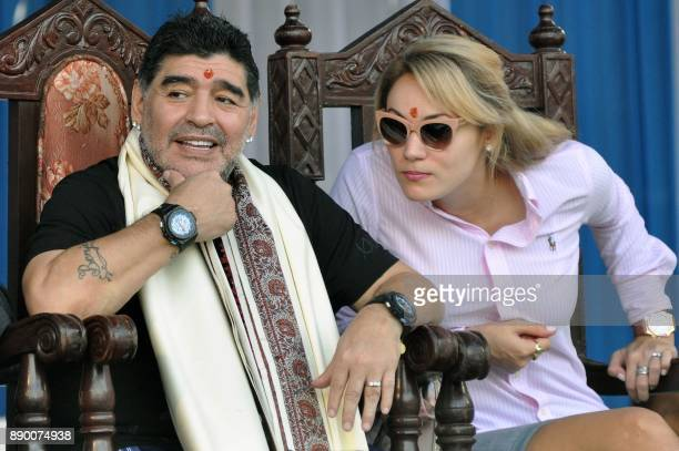 Argentine footballer Diego Maradona with his wife look on during a visit in Kolkata on December 11 2017 Maradona is on a private visit to India / AFP...