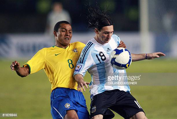 Argentine footballer Lionel Messi vies for the ball with Brazil's Gilberto Silva during their FIFA World Cup South Africa2010 qualifier football...