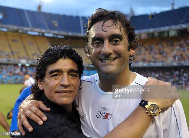 Argentine former football legend and national team head coach Diego Maradona poses with Uruguay's former footballer Enzo Francescoli during a...