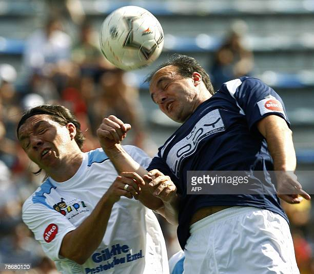 Argentine former football players Abel Balbo and Pablo Rochen vie for the ball during a friendly match called 'To the Playing Field for a Smile' 30...