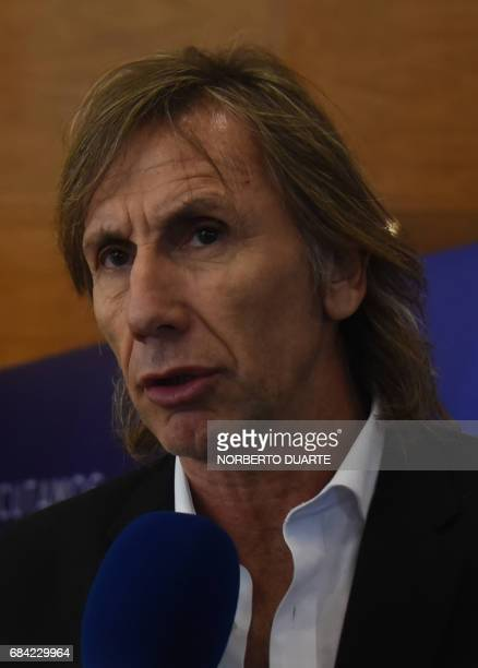 Argentine former footballer and current manager of the Peruvian national football team Ricardo Gareca speaks to the pres at the South American...
