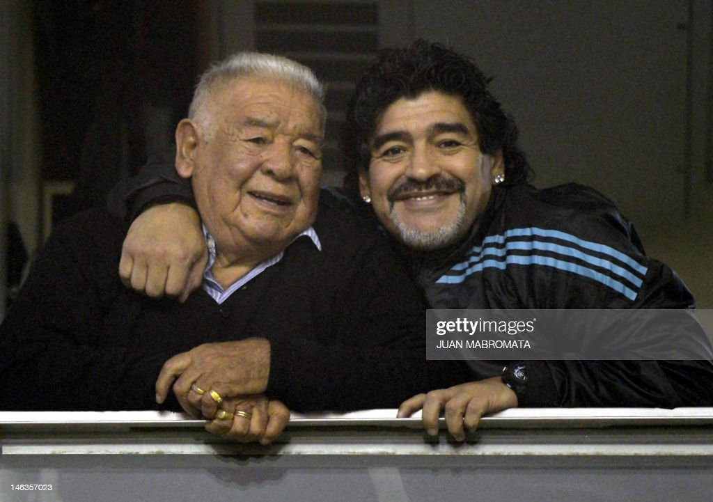 Argentine former footballer and United Arab Emirates Al Wasl coach Diego Maradona (R) embraces his father 'Don Diego' before the start of the Copa Libertadores 2012 first leg semifinal football match between Argentina's Boca Juniors and Universidad de Chile at 'La Bombonera' stadium in Buenos Aires, Argentina, on June 14, 2012. AFP PHOTO / Juan Mabromata
