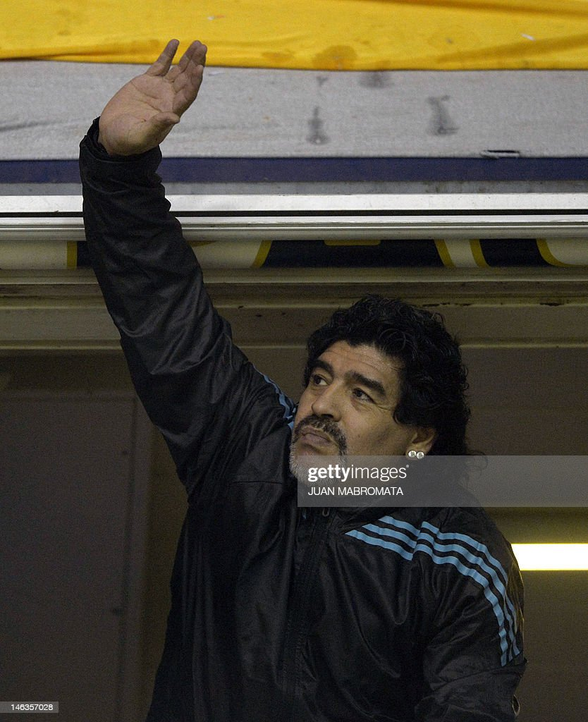 Argentine former footballer and United Arab Emirates Al Wasl coach Diego Maradona waves before the start of the Copa Libertadores 2012 first leg semifinal football match between Argentina's Boca Juniors and Universidad de Chile at 'La Bombonera' stadium in Buenos Aires, Argentina, on June 14, 2012. AFP PHOTO / Juan Mabromata
