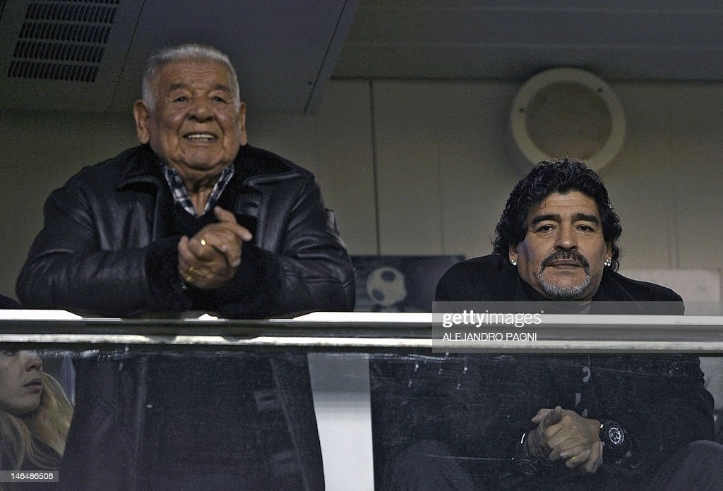Argentine former footballer and United Arab Emirates Al Wasl team coach Diego Maradona (R) and his father, 'Don Diego', wait for the start of the match between Boca Juniors and Arsenal at 'La Bombonera' stadium in Buenos Aires, Argentina, on June 17, 2012. AFP PHOTO / Alejandro PAGNI