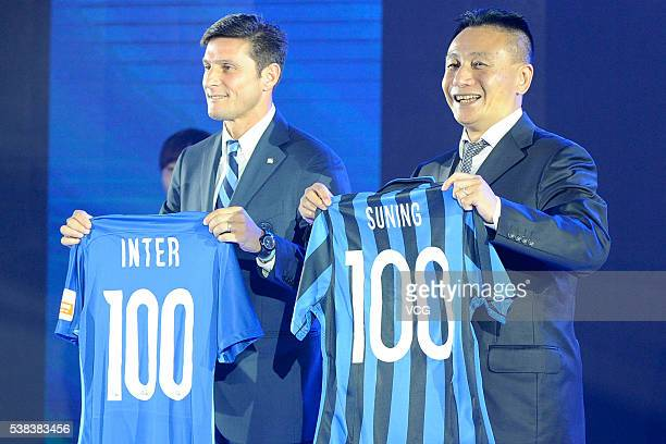 Argentine former footballer Javier Zanetti and Gong Lei Chinese football Head coach at Chinese Super League side Guizhou Renhe attend the Press...