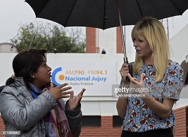 Argentine former model Karina Rabolini wife of Buenos Aires governor and presidential precandidate Daniel Scioli talks with a woman outside the...