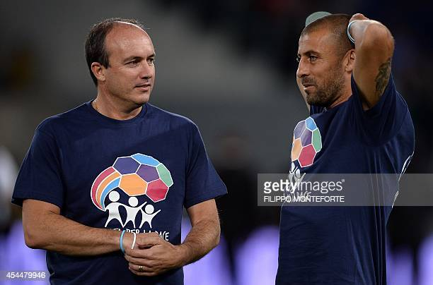Argentine forward Abel Eduardo Balbo and defender Walter Samuel stand during the inter religious 'match for peace' football game in Rome's Olympic...