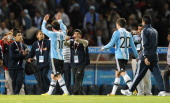 Argentine forward Lionel Messi and midfielder Fernando Gago celebrate at the end of their 2011 Copa America Group A first round football match...