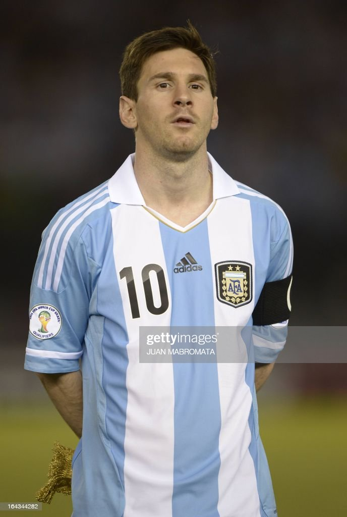 Argentine forward Lionel Messi is seen during a moment of silence for the late Venezuelan President Hugo Chavez before their FIFA World Cup Brazil 2014 South American qualifying football match against Venezuela in Buenos Aires, Argentina on March 22, 2013. AFP PHOTO / JUAN MABROMATA