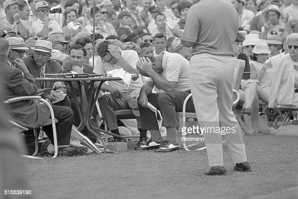 Argentine golfer Roberto De Vicenzo holds his head after he signed incorrect scorecard and cost himself a tie for the Masters Golf Tourney here on...
