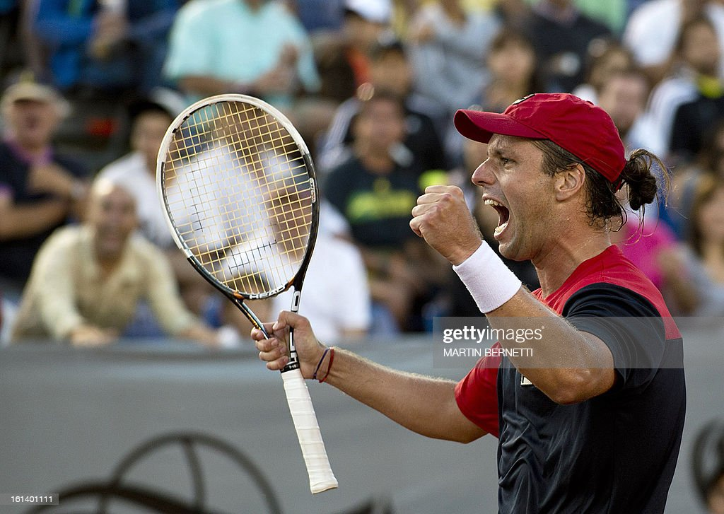 Argentine Horacio Zeballos celebrates his victory over Spanish tennis player Rafael Nadal at the ATP Vina del Mar tournament final singles match, in Vina del Mar, about 120 km northwest of Santiago, on February 10, 2013. AFP PHOTO/MARTIN BERNETTI