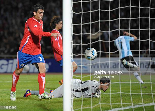 Argentine midfielder Angel di Maria runs to celebrate with teammates after scoring the 3rd goal of his team while Costa Ricans Johnny Acosta and...