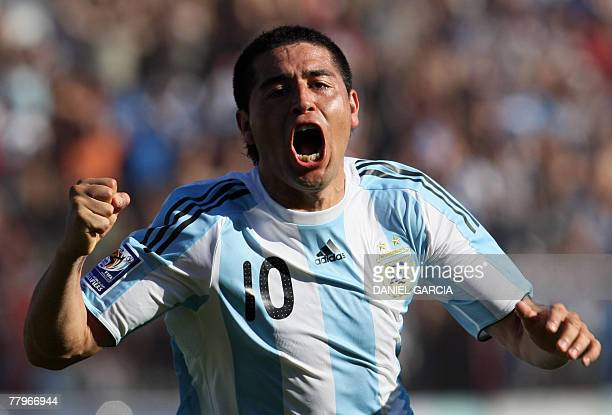 Argentine midfielder Juan Roman Riquelme celebrates after scoring the team's second goal against Bolivia during the South American qualifiers for the...