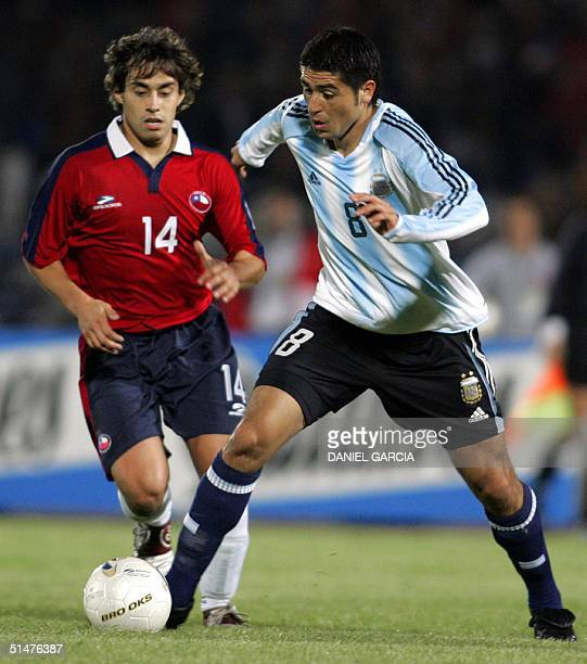 Argentine midfielder Juan Roman Riquelme vies for the ball with Chilean midfielder Jorge Valdivia during their FIFA World Cup South American...