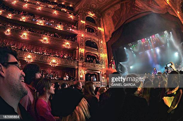 Argentine musician Charly Garcia performs on stage at the Colon theater during his Lineas Paralelas Artificio Imposible show as he is cheered by the...