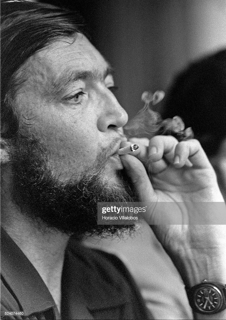 Argentine novelist Julio Cortazar puffs a smoke during a meeting at the CGT de los Argentinos where he announced he was to donate the profits of his...