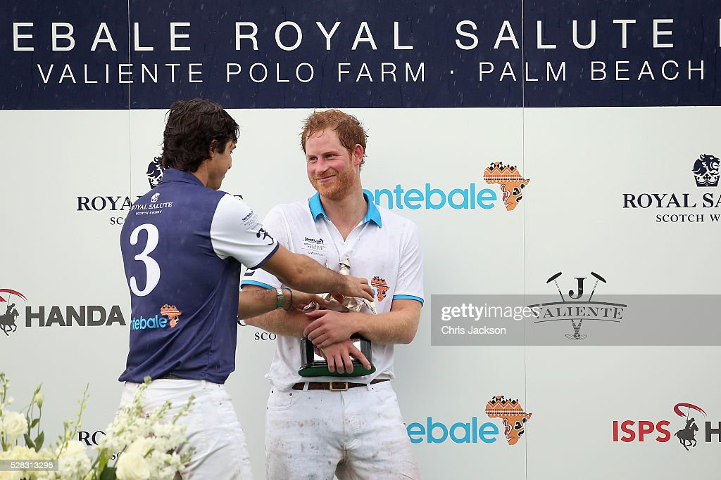 Argentine player Nacho Figueras (L) and Prince Harry pose after competing during the Sentebale Royal Salute Polo Cup in Palm Beach with Prince Harry at Valiente Polo Farm on May 4, 2016 in Palm Beach, United. The event will raise money for Prince Harry's charity Sentebale, which supports vulnerable children and young people living with HIV in Lesotho in southern Africa.