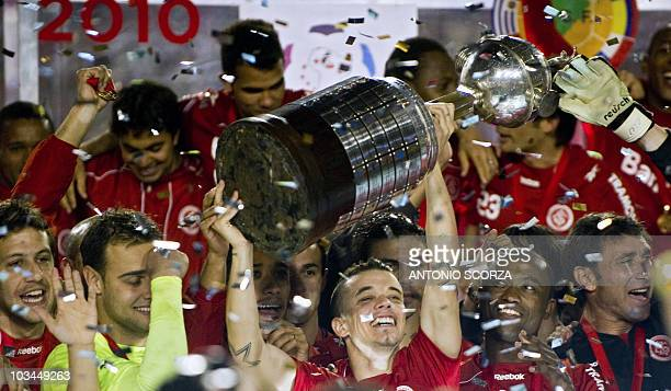Argentine player of Brazil's Internacional forward Andres D'Alessandro holds up the Libertadores Cup on August 18 2010 at Beira Rio stadium in Porto...