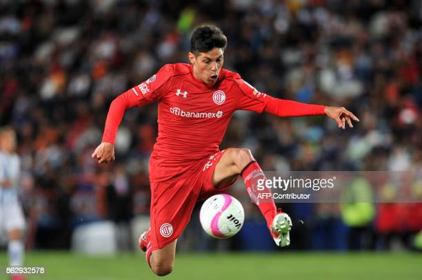 Argentine player Pablo Barrientos of Toluca controls the ball during their Mexican Apertura tournament football match against Pachuca at the Hidalgo...