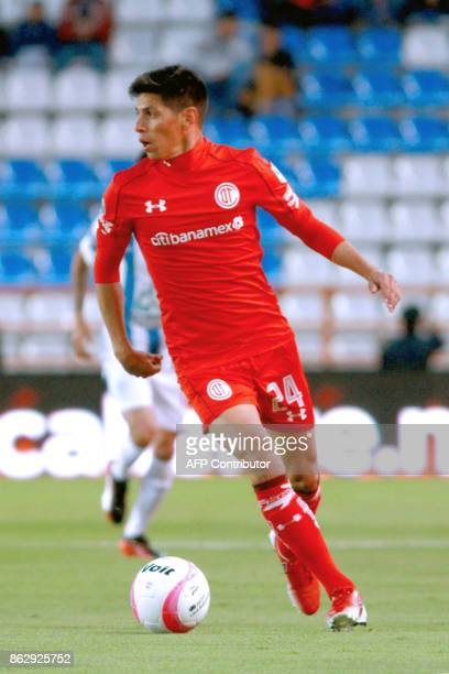 Argentine player Pablo Barrientos of Toluca runs with the ball during their Mexican Apertura tournament football match against Pachuca at the Hidalgo...
