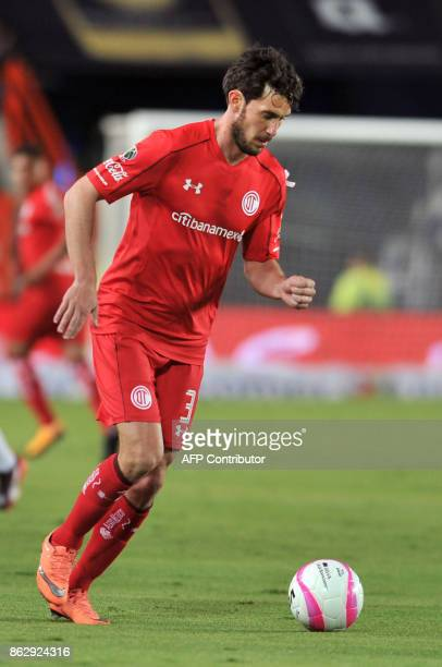 Argentine player Santiago Garcia of Toluca runs with the ball during the Mexican Apertura tournament match against Pachuca at the Hidalgo stadium on...