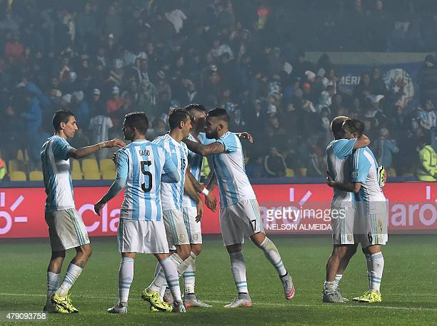 Argentine players celebrate after beating Paraguay 61 in their Copa America semifinal football match in Concepcion Chile on June 30 2015 AFP PHOTO /...