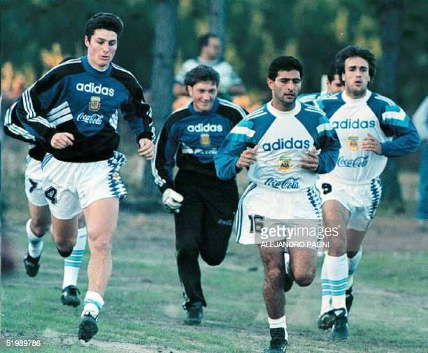 Argentine players Javier Zanetti Rolando Cristante Leonardo Astrada and Gabriel Batistuta run 10 July during a practice session in Paysandu Uruguay...