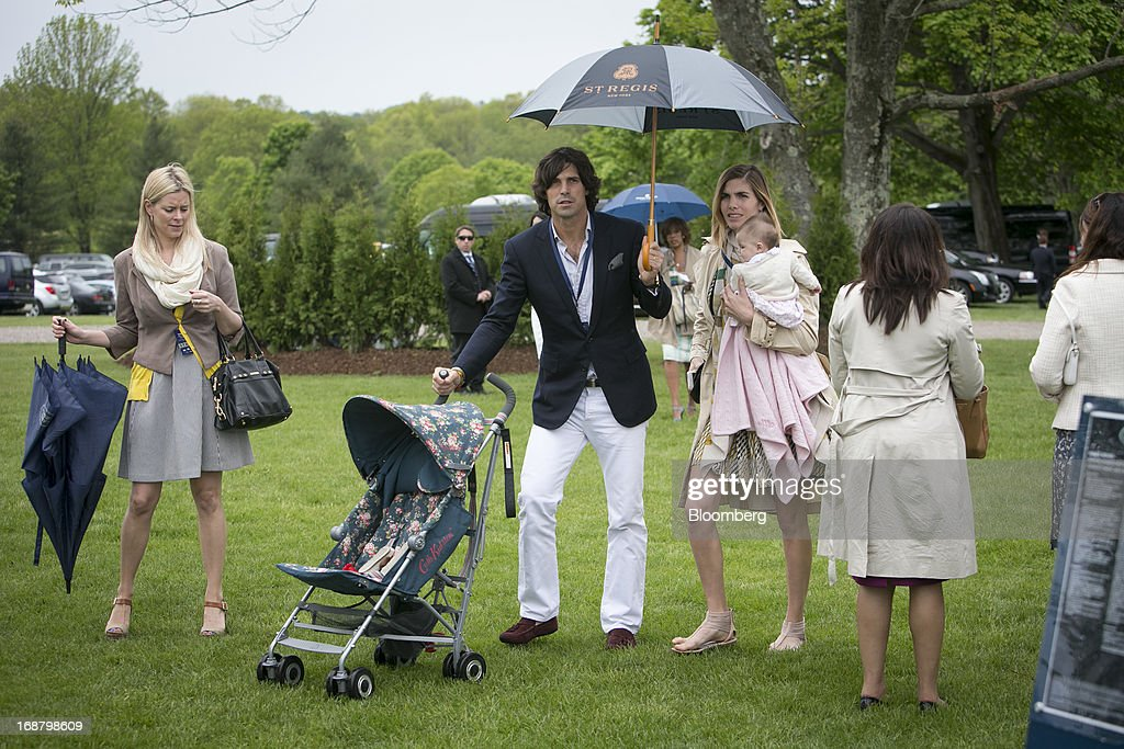 Argentine polo player <a gi-track='captionPersonalityLinkClicked' href=/galleries/search?phrase=Nacho+Figueras&family=editorial&specificpeople=2308997 ng-click='$event.stopPropagation()'>Nacho Figueras</a>, second left, arrives during the Sentebale Royal Salute Polo Cup at the Greenwich Polo Club in Greenwich, Connecticut, U.S., on Wednesday, May 15, 2013. Prince Harry of Wales' visit is part of a week-long U.S. tour that also includes stops in Washington, Colorado and New York. Photographer: Scott Eells/Bloomberg via Getty Images
