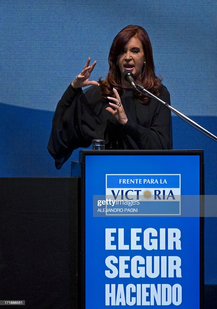 Argentine President Cristina Fernandez de Kirchner delivers a speech during the presentation of the ruling Frente para la Victoria (FPV) party candidates for the Congress, in Buenos Aires on June 29, 2013. Argentina will hold primary --obligatory-- elections next August 11. AFP PHOTO / Alejandro PAGNI