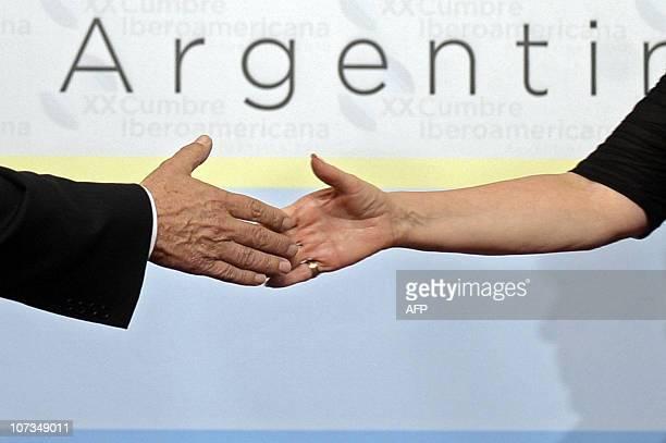 Argentine President Cristina Fernandez de Kirchner greets Brazilian President Luiz Inacio Lula Da Silva during the XX IberoAmerican Summit on...