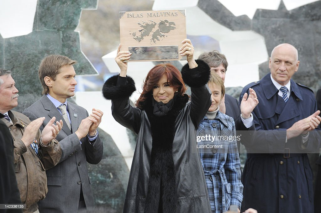 Argentine president Cristina Fernandez de Kirchner holds a plaque prior to give a speech during an act in honor to the soldiers that took part in the...