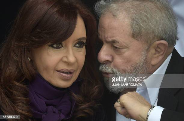 Argentine President Cristina Fernandez de Kirchner listens to Brazilian former President Luiz Inacio Lula da Silva as Buenos Aires governor and...