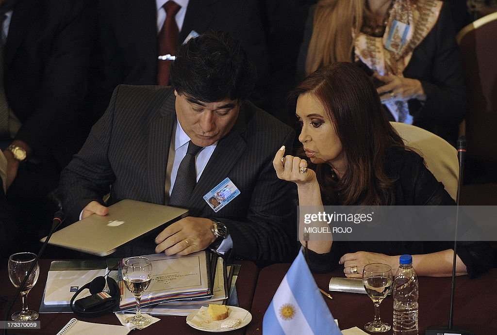 Argentine President Cristina Fernandez de Kirchner (R) speaks to the Legal and Technical Secretary of Argentina's Presidency, Carlos Alberto Zannini, during the plenary session of the XLV Mercosur Summit, at the headquarters of the bloc in Montevideo on July 12, 2013. Leaders of the South American trade bloc that includes Argentina, Brazil, Uruguay and Venezuela, agreed to a statement reaffirming the fundamental right of asylum, Maduro said Friday amid a test of wills with Washington over the fate of US intelligence leaker Edward Snowden.