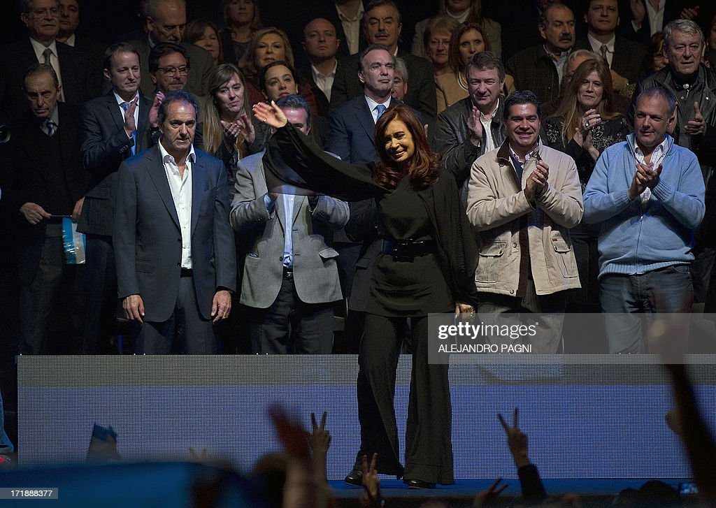 Argentine President Cristina Fernandez de Kirchner waves to supporters during the presentation of the ruling Frente para la Victoria (FPV) party candidates for the Congress, in Buenos Aires on June 29, 2013. Argentina will hold primary --obligatory-- elections next August 11. AFP PHOTO / Alejandro PAGNI