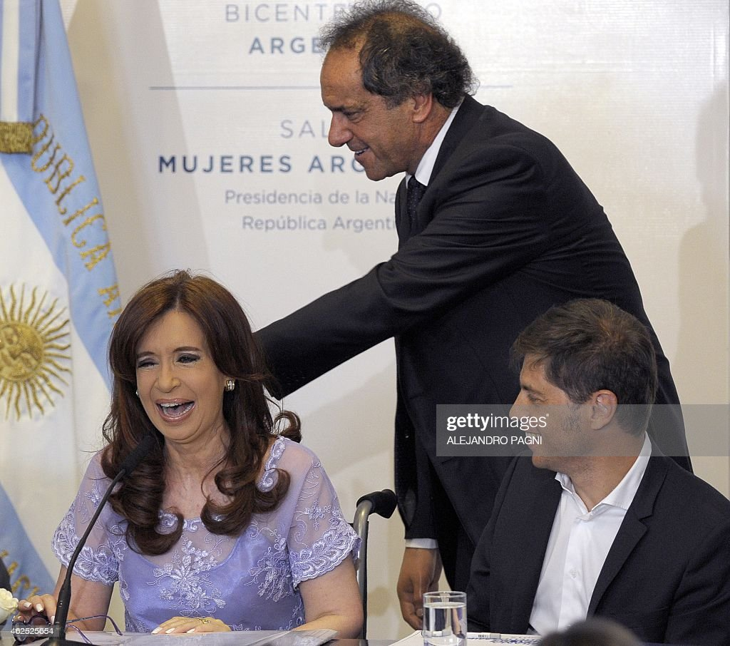 Argentine President Cristina Kirchner (L) laugh accompanied by her Economy Minister <a gi-track='captionPersonalityLinkClicked' href=/galleries/search?phrase=Axel+Kicillof&family=editorial&specificpeople=9189054 ng-click='$event.stopPropagation()'>Axel Kicillof</a> (R) and Buenos Aires province Governor and presidential candidate for the October 2015 election <a gi-track='captionPersonalityLinkClicked' href=/galleries/search?phrase=Daniel+Scioli&family=editorial&specificpeople=616127 ng-click='$event.stopPropagation()'>Daniel Scioli</a> during a ceremony with provincial governors, in Buenos Aires, on January 30, 2015. President Cristina Kirchner on Monday said that she will disband Argentina's intelligence service after a prosecutor was found dead just hours before he was to make explosive allegations against her.