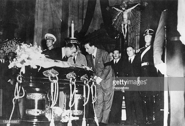 Argentine President Juan Peron bows before the coffin of his wife Eva at the Ministry of Labour building Buenos Aires 27th July 1952 With Peron is...