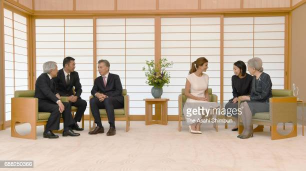 Argentine President Mauricio Macri and his wife Juliana Awada talks with Emperor Akihito and Empress Michiko respectively during their meeting at the...