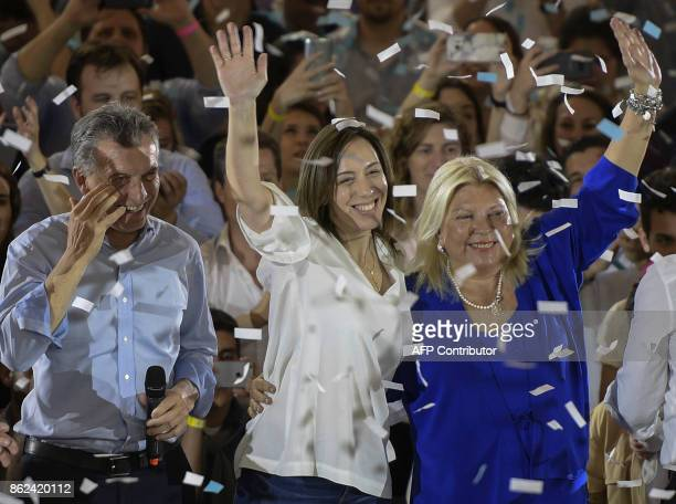 Argentine President Mauricio Macri gestures while Buenos Aires Governor Maria Eugenia Vidal and Cambiemos party legislator candidate for Buenos Aires...