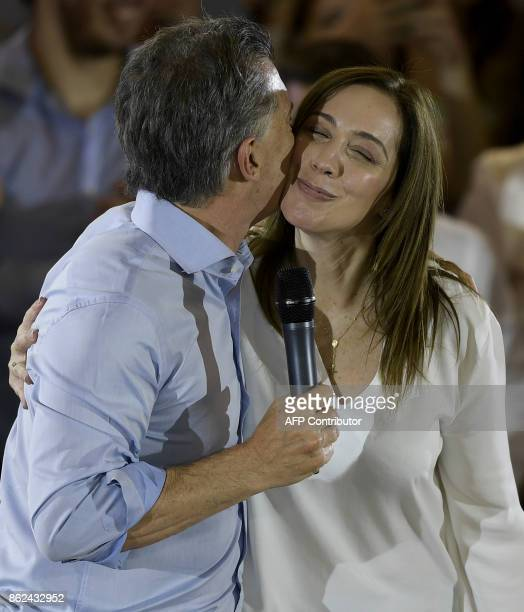 Argentine President Mauricio Macri kisses Buenos Aires Governor Maria Eugenia Vidal in Buenos Aires on October 17 2017 during the closure campaign of...