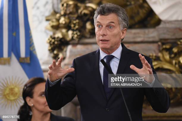 Argentine President Mauricio Macri speaks next to vice President Gabriela Michetti during the swearingin ceremony of the new Foreign Minister Jorge...