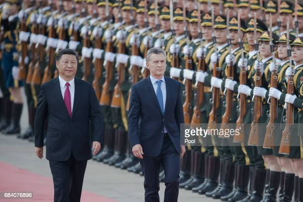 Argentine President Mauricio Macri walks with Chinese President Xi Jinping during a welcome ceremony outside the Great Hall of the People on May 17...
