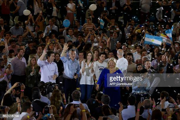 Argentine President Mauricio Macri waves next to Buenos Aires Governor Maria Eugenia Vidal Cambiemos party legislator candidate for Buenos Aires city...