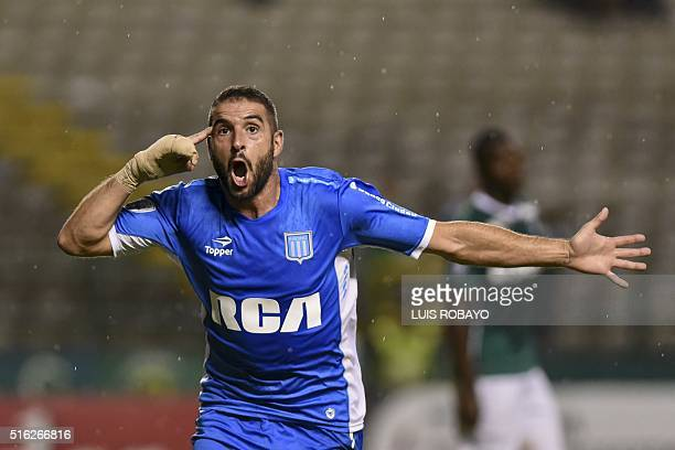 Argentine Racing Club forward Lisandro Lopez celebrates his goal against Colombia's Deportivo Cali during their Copa Libertadores 2016 tournament...