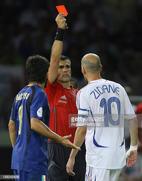 Argentine referee Horacio Elizondo shows a red card to French midfielder Zinedine Zidane next to Italian midfielder Gennaro Gattuso during the World...