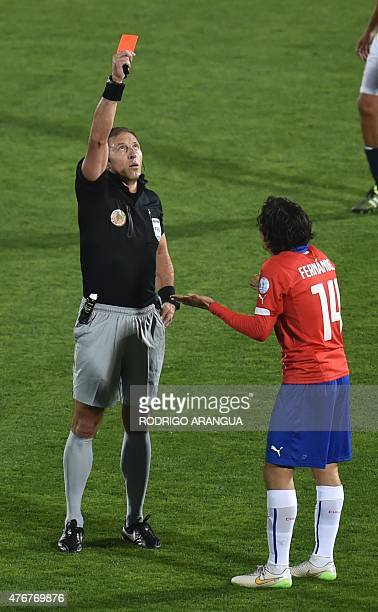 Argentine referee Nestor Pitana shows a red card to Chile's midfielder Matias Fernandez during the Copa America inauguration match against Ecuador on...