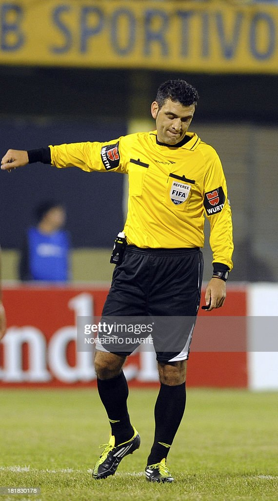 Argentine referee Saul Laverni gestures during the Copa Sudamericana football match between Paraguay's Libertad and Brazil's Sport Recife, at Feliciano Caceres stadium in Luque, Paraguay on September 25, 2013.