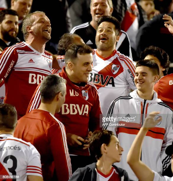 Argentine River Plate fans cheer for their team before the start of their Libertadores Cup football match before the quarterfinals against Paraguay's...