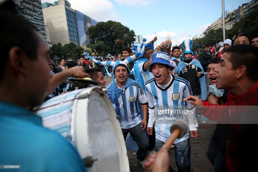 Argentine soccer fans show their spirit as the country waits for the start of the World Cup final on July 13, 2014 in Buenos Aires, Argentina. Argentina, a two time World Cup winner, will play against Germany in Rio de Janeiro, Brazil today for the World Cup trophy.
