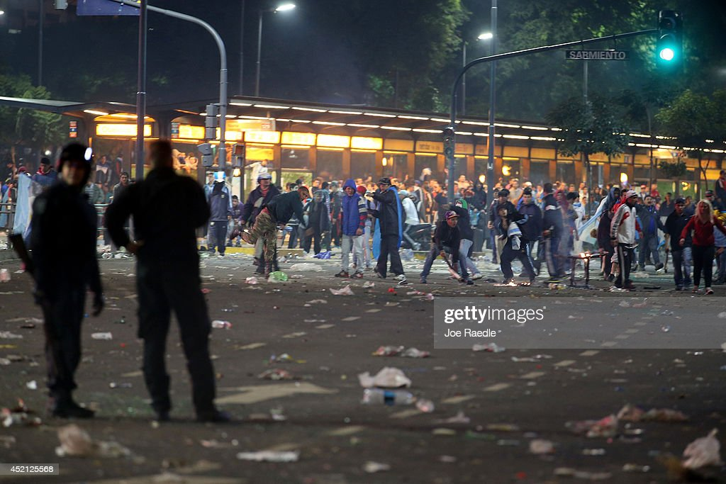 Argentine soccer fans throw rocks and other debris at police officers after violence broke out near the Obelisco de Buenos Aires after their team lost to Germany 1-0 during the World Cup final on July 13, 2014 in Buenos Aires, Argentina. Germany won their 4th World Cup in the final match played in Rio de Janeiro.